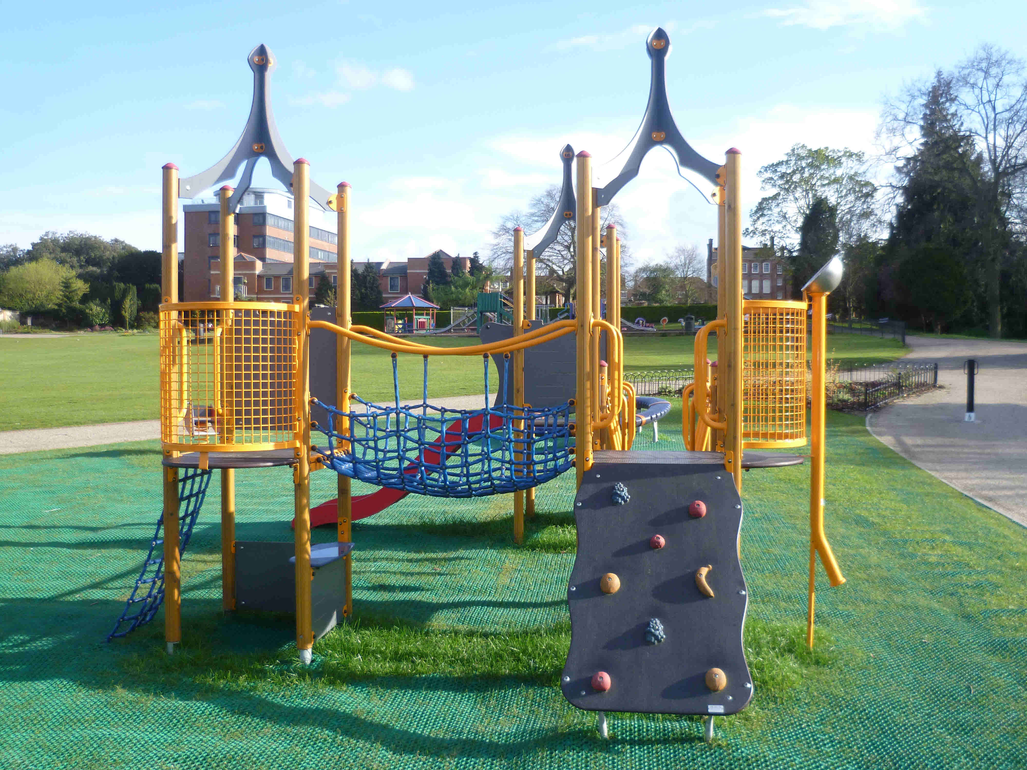 The top part of the playpark has mini climbing frames, swings, sandpit ...